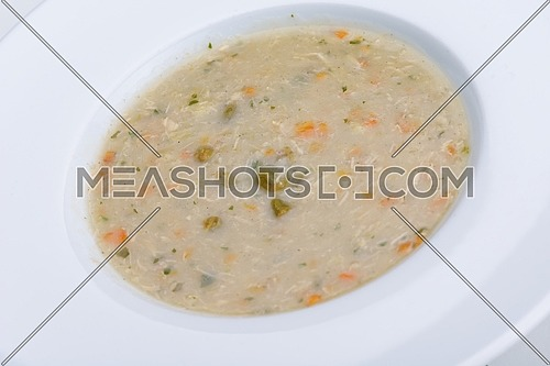 vegetable cream soup closeup isolated on white background