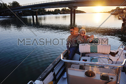 happy young couple in love  have romantic time at summer sunset   at ship boat while  representing urban and countryside fashin lifestyle