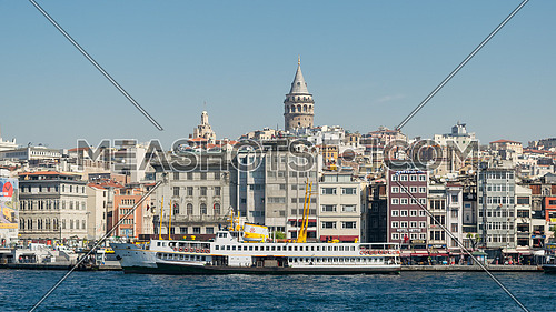 Istanbul, Turkey - April 26, 2017: City view of Istanbul, Turkey from the sea overlooking Galata Tower and Karakoy ferry terminal