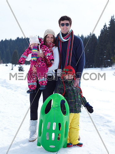 Winter playing, fun, snow and family portrait  sledding at winter time