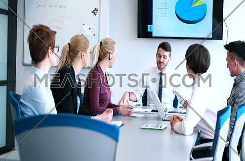 mid-shot business people meeting and brainstorming about project
