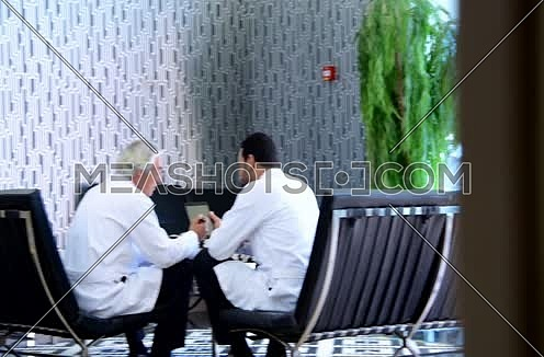 pan shot middle eastern doctors meeting and discussing with team
