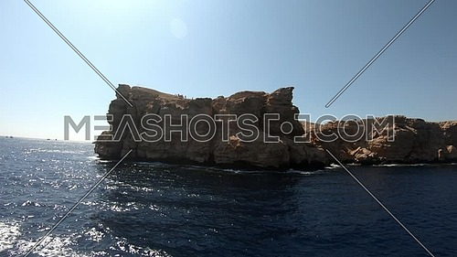 Long shot from Red Sea showing Ras Muhammed Island at day