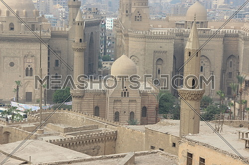 a photo from Salah el Din Castle in Cairo , Egypt showing the view of several historical mosques