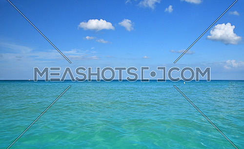 Tranquil seascape of turquoise blue sea water and clear sky with horizon, summer day, low angle view