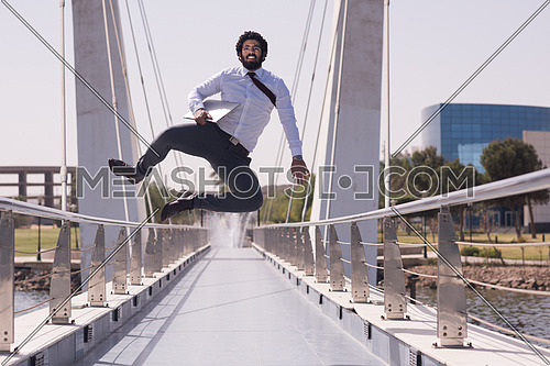 succesfull young business man jumping  and running