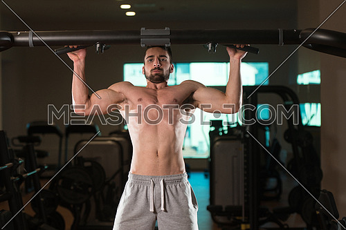 Young Muscular Fitness Bodybuilder Doing Heavy Weight Exercise For Back In The Gym