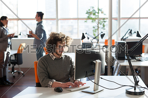 Young Entrepreneur Freelancer Working Using A computer In Coworking space