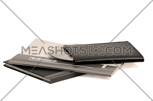 assorted notebooks with a cd flat piled on white background,sepia filter