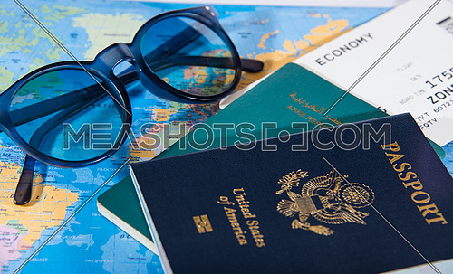 american passport and egyptian passport on map travel concept