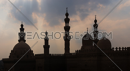 Silhouette shot of minarets and domes of Sultan Hasan mosque and Al Rifai Mosque, Old Cairo, Egypt