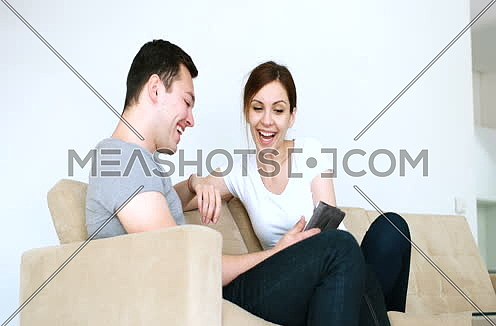 couple having fun while using internet on digital tablet