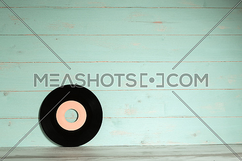 Vinyl record on wooden background,old style