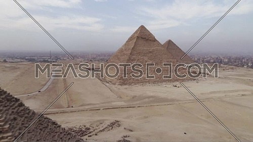 Reveal Shot for The Great Pyramids of Giza in Cairo by day.