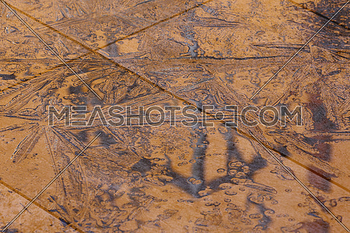 Water and ice on ceramic tiles background or texture