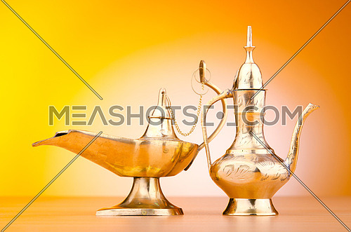 Ancient lamp against gradient background