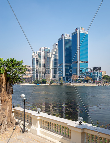 Cairo, Egypt - March 10, 2018: City view from River Nile overlooking Head Office of National Bank of Egypt and St. Regis hotel, Egypt