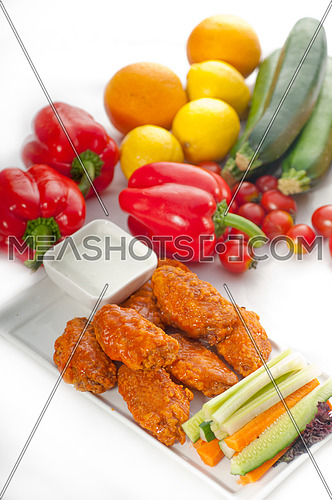 classic  buffalo chicken wings served with fresh pinzimonio and vegetables on background,MORE DELICIOUS FOOD ON PORTFOLIO