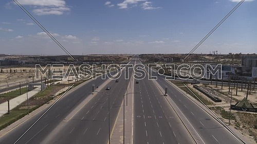 Aerial shot flying over Dahshur Road at 6th of October City during the corona pandemic lockdown by day 10 April