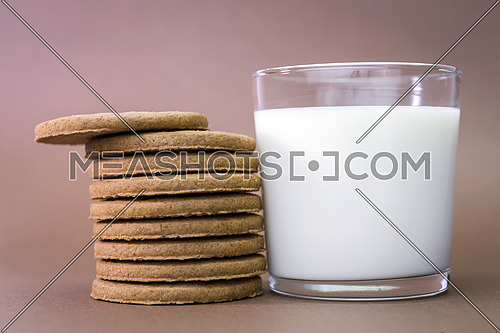 Glass of milk and biscuits round