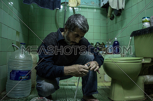 A Syrian businessman working as a plumber after the syrian uprising