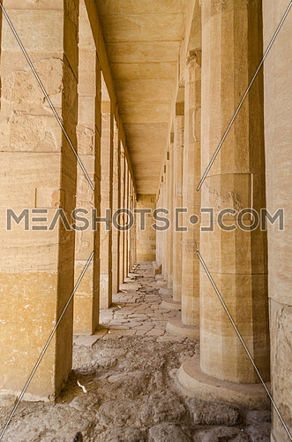 Huge old columns in a pharaoh temple at Deir El-Bahri Temple in Luxor at day