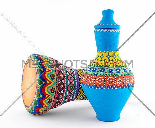 Two pieces of colorful painted potteries, an Egyptian drinking jar (arabic: Kolla) and a goblet drum (also chalice drum, tarabuka, darbuka, debuka)