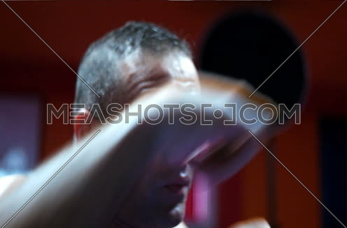 Portrait Of  Fighter or Boxer Throwing Punches Towards Camera