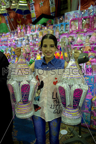 Little girl holding two big lanterns of the holy month of Ramadan