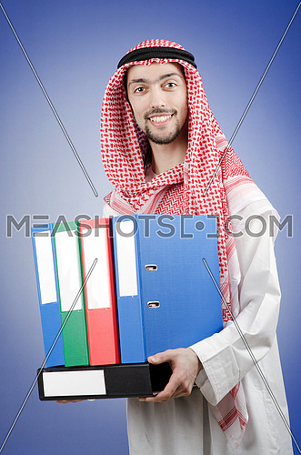 Arab businessman with office folders