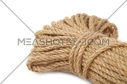 One big coil skein of natural brown twine hessian burlap jute rope isolated on white background, close up, high angle view