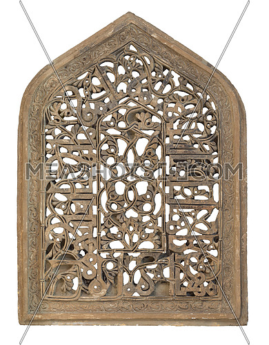 Perforated arched stucco window decorated with floral patterns, one of the traditions of the Fatimid era, isolated on white with clipping path