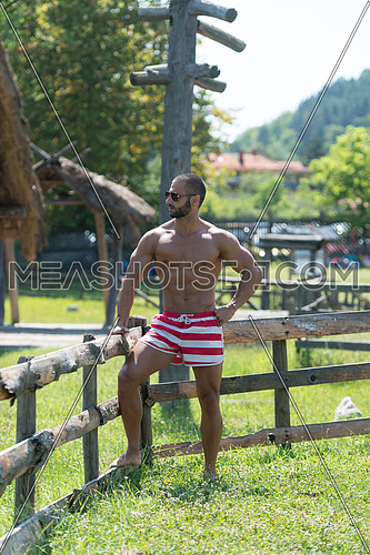 Smiling Athlete With Naked Torso Resting Outdoors