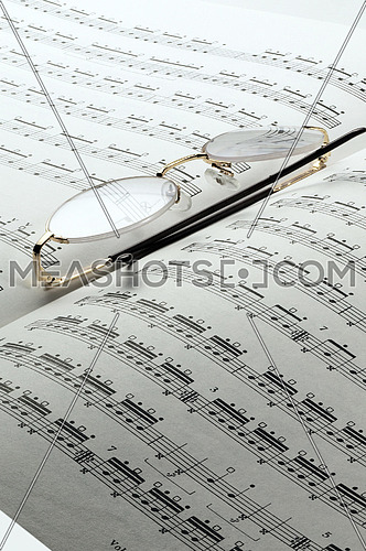 percussion and drums music charts with glasses on top