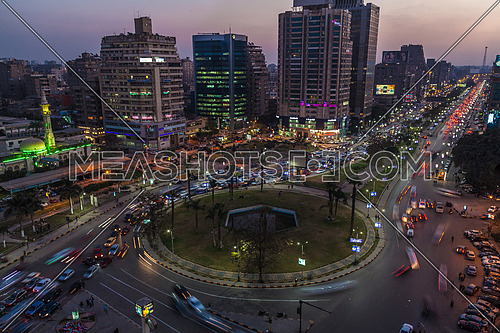 Long shot for traffic in Moustafa Mahmoud Square at Cairo at Sunset