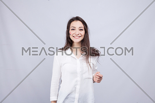 Ayoung girl standing on a white background