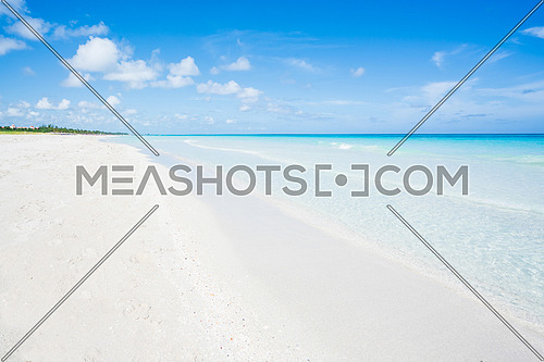 wonderful beach of Varadero during a sunny day, fine white sand and turquoise and blue Caribbean sea,sky with clouds,Cuba.