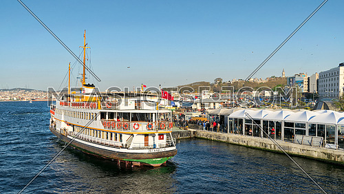 Istanbul, Turkey - April 25, 2017: Passengers Loading into local ferry in Eminonu ferry terminal before sunset, Istanbul, Turkey