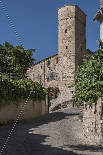"Trujillo, Spain - July 14, 2018: Torre de los enamorados, next to Romanesque tower of the Church of Santiago and that of the strong house of Luis Chaves, ""the old"". Trujillo, Caceres Province, Spain"