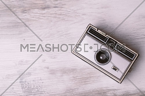 Retro classic 35mm photo camera on gray Background