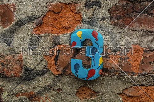 Number three on a house wall