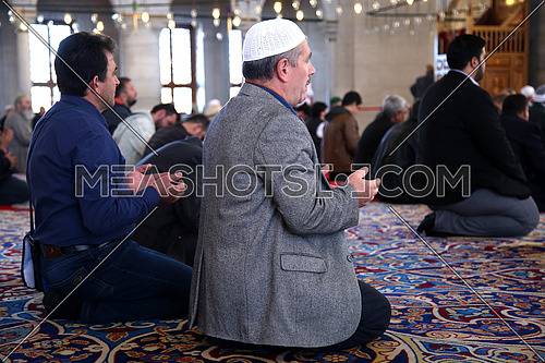A Turkish Prayer in Fatih Mosque in Istanbul following the Emam.