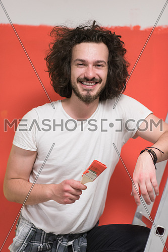 Portrait of a beautiful  young man with funny hair and brush over color background with copyspace expressing different emotions