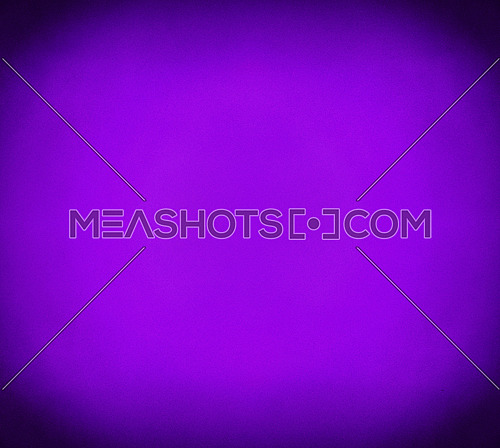 Abstract purple and violet grunge background with noise grain texture, vivid color gradient from center and dark shaded corners