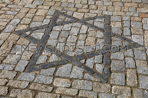 Close up background with Star of David, Magen David, Jewish religious and cultural heritage symbol on cobblestone paved road, high angle view