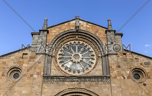 Avila, SPAIN - 10 august 2015: Santa Teresa Square, Front of the Church of San Pedro, main facade stands out its Cistercian rosette, Avila, Spain