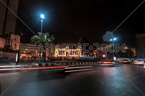 Long long shot for traffic towards Alexandria Naval Unknown Soldier Memorial at night