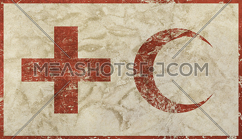 Old grunge faded flag of Red Cross and Crescent