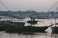 Two Fisher men in a boat during the sunrise at the Early morning in AlQanatir - Egypt