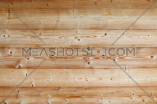 Light brown old vintage knotty wooden wide planks wall background texture with contrast woodgrain pattern